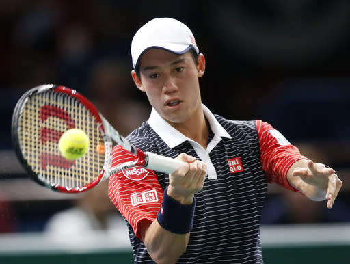 Kei Nishikori of Japan, returns the ball to David Ferrer of Spain during their quarterfinal match at the ATP World Tour Masters tennis tournament at Bercy stadium in Paris, France, Friday, Oct. 31, 2014. (AP Photo/Michel Euler)