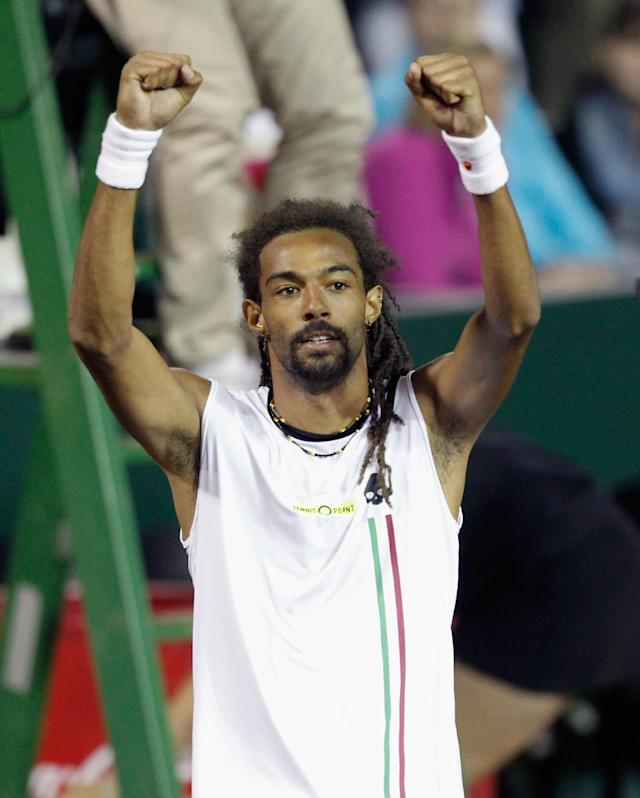 Dustin Brown, of Germany, celebrates after defeating John Isner, of the United States, 6-4, 6-7 (7), 7-6 (4) during the U.S. Clay Court Tennis Championship tournament, Wednesday, April 9, 2014, in Houston. (AP Photo/Houston Chronicle, Bob Levey)