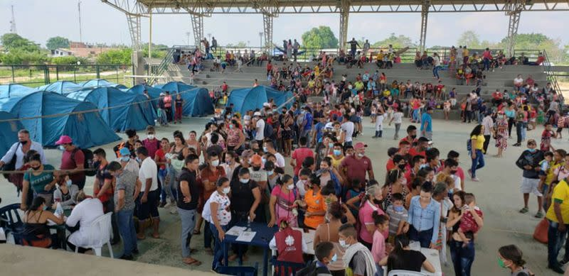 Venezuelan migrants are seen inside a coliseum where a temporary camp is installed, after fleeing their country due to military operations, according to the Colombian migration agency, in Arauquita