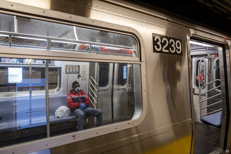 New York City, USA - March 19, 2020: A man riding the subway wears a respirator mask during the coronavirus outbreak in New York City.