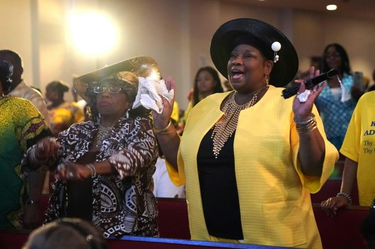 People pray and celebrate the life of singer Aretha Franklin at New Bethel Baptist Church in Detroit, where her father was the pastor, on August 19, 2018 -- the first Sunday service since her death at age 76
