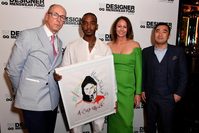 Samuel Ross (second left) displays his BFC/GQ designer menswear prize … with GQ editor Dylan Jones, Caroline Rush, CEO of the British Fashion Council and Kevin Jiang. vice president of JD.com.