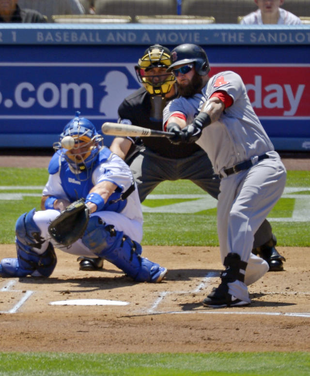 Boston Red Sox's Mike Napoli, right, hits an RBI single as Los Angeles Dodgers catcher A.J. Ellis, left, and home plate umpire Dan Iassogna look on during the first inning of a baseball game, Saturday, Aug. 24, 2013, in Los Angeles. (AP Photo/Mark J. Terrill)