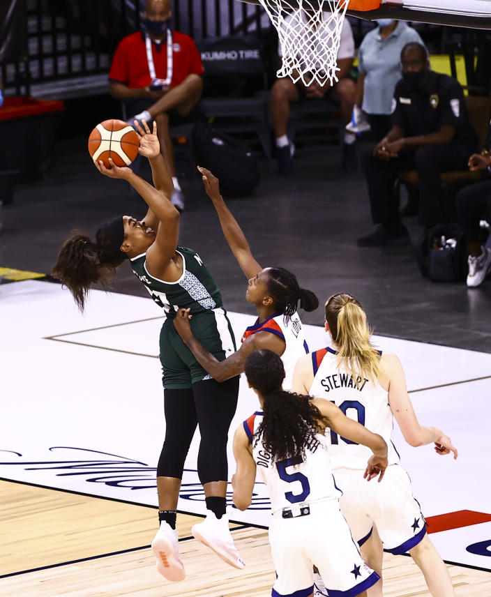 Nigeria guard Erinma Ogwumike (31) shoots over United States guard Jewell Loyd during the first half of a pre-Olympic exhibition basketball game in Las Vegas on Sunday, July 18, 2021. (Chase Stevens/Las Vegas Review-Journal via AP)