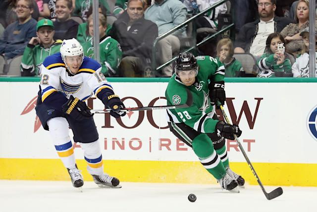 DALLAS, TX - MARCH 12: Stephen Johns #28 of the Dallas Stars controls the puck against Jori Lehtera #12 of the St. Louis Blues in the second period at American Airlines Center on March 12, 2016 in Dallas, Texas. (Photo by Tom Pennington/Getty Images)