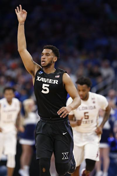 Xavier guard Trevon Bluiett (5) celebrates a 3-point shot during the second half against Florida State in the second round of the NCAA men's college basketball tournament, Saturday, March 18, 2017 in Orlando, Fla. Xavier defeated Florida State 91-66. (AP Photo/Wilfredo Lee)