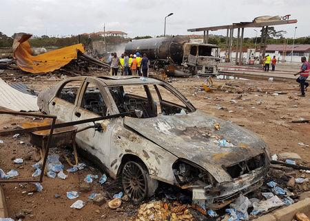 Burnt vehicles are pictured at the site of an explosion at a gas depot in Accra