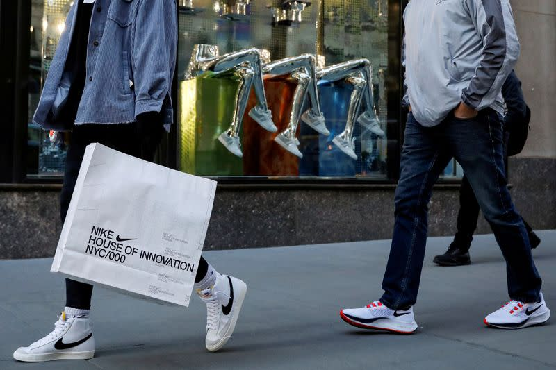 FILE PHOTO: People shop on 5th Avenue in New York