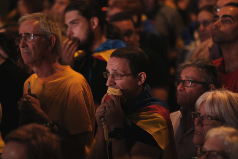 Pro-independence supporters react during a recent rally