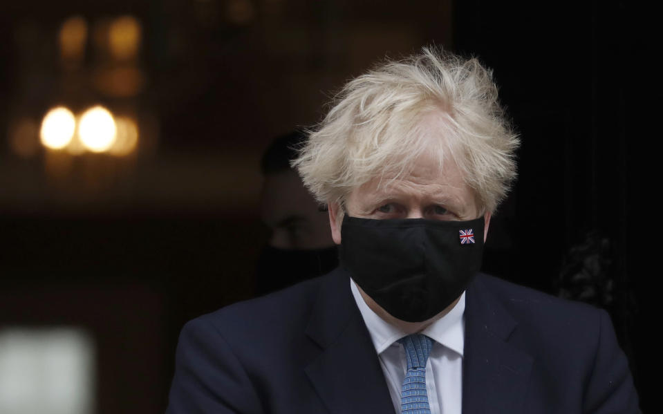 Britain's Prime Minister Boris Johnson leaves 10 Downing Street for a debate on the Queen Speech at House of Commons in London, Wednesday, May 12, 2021. (AP Photo/Alastair Grant)