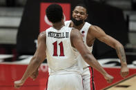 San Diego State forward Keshad Johnson, right, and forward Matt Mitchell (11) celebrate a point during the second half of an NCAA college basketball game against Boise State Saturday, Feb 27, 2021, in San Diego. (AP Photo/Gregory Bull)