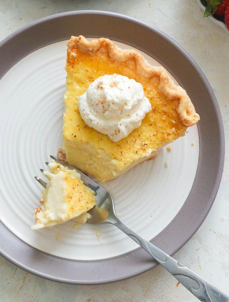 "<p>Why make dessert complicated? This custard pie will satisfy your entire Easter crowd with one bite.</p><p><strong>Get the recipe at <a href=""https://www.africanbites.com/egg-custard-pie/"" rel=""nofollow noopener"" target=""_blank"" data-ylk=""slk:Immaculate Bites"" class=""link rapid-noclick-resp"">Immaculate Bites</a>.</strong></p><p><strong><a class=""link rapid-noclick-resp"" href=""https://go.redirectingat.com?id=74968X1596630&url=https%3A%2F%2Fwww.walmart.com%2Fbrowse%2Fhome%2Fpie-dishes-tart-pans%2F4044_623679_8455465_4674050%3Ffacet%3Dbrand%253AThe%2BPioneer%2BWoman&sref=https%3A%2F%2Fwww.thepioneerwoman.com%2Ffood-cooking%2Fmeals-menus%2Fg35408493%2Feaster-desserts%2F"" rel=""nofollow noopener"" target=""_blank"" data-ylk=""slk:SHOP PIE PLATES"">SHOP PIE PLATES</a><br></strong></p>"
