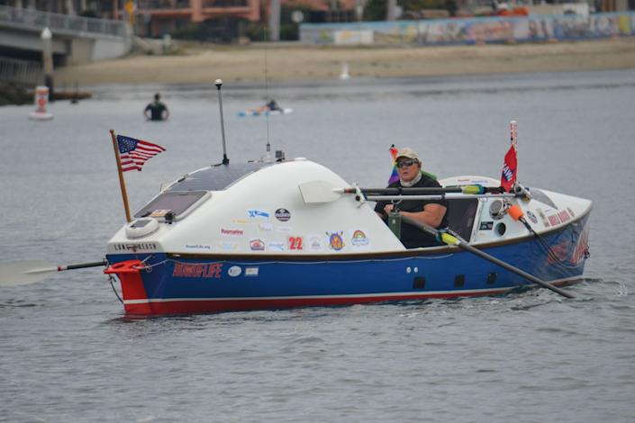 """Angela Madsen on her boat. <span class=""""copyright"""">(Courtesy of Deb Madsen)</span>"""
