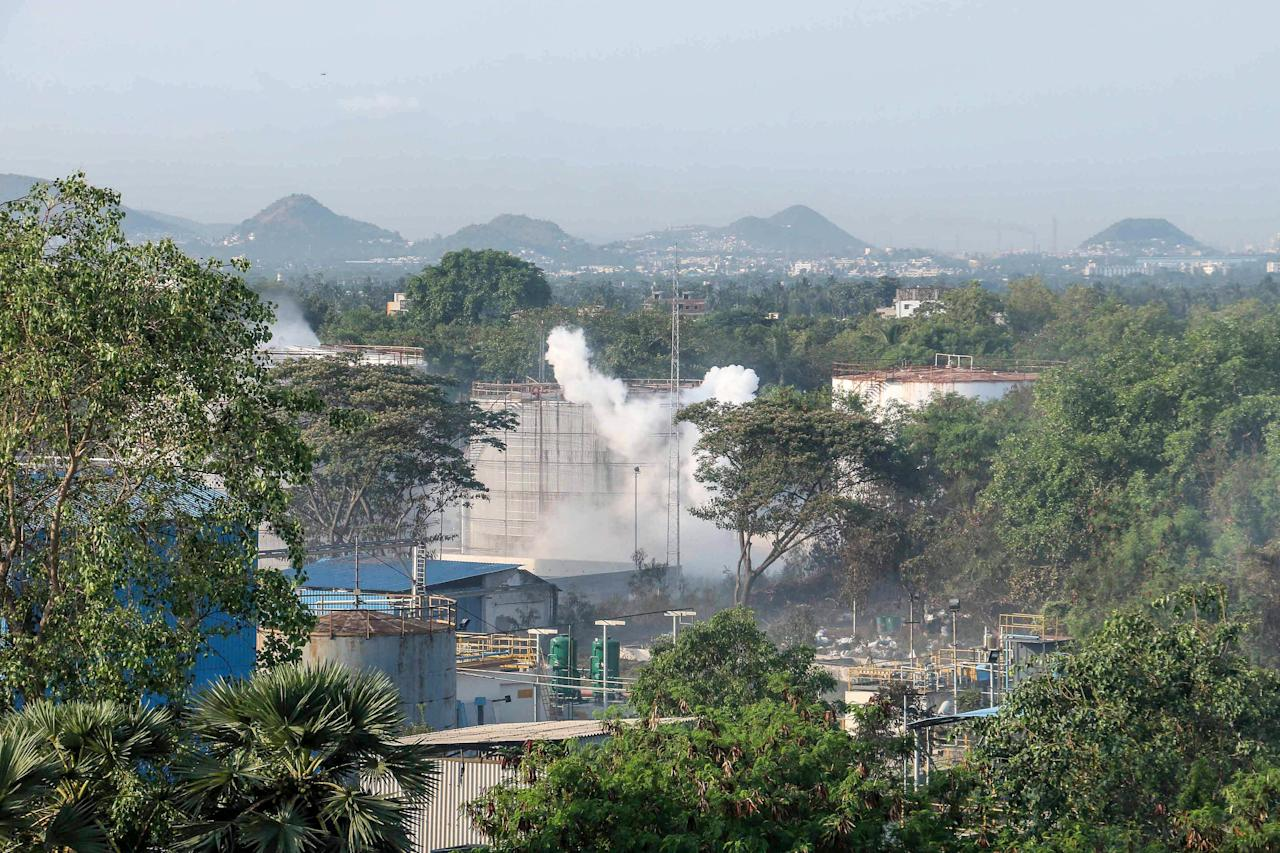 Smokes rise from an LG Polymers plant following a gas leak incident in Visakhapatnam on May 7, 2020. - Eleven people were killed and hundreds hospitalised after a pre-dawn gas leak at a chemical plant in eastern India on May 7 that left unconscious victims lying in the streets, authorities said. Fears that the death toll from the incident on the outskirts of the Visakhapatnam, an industrial port city in Andhra Pradesh state, might rise significantly were not borne out however. (Photo by STR / AFP) (Photo by STR/AFP via Getty Images)