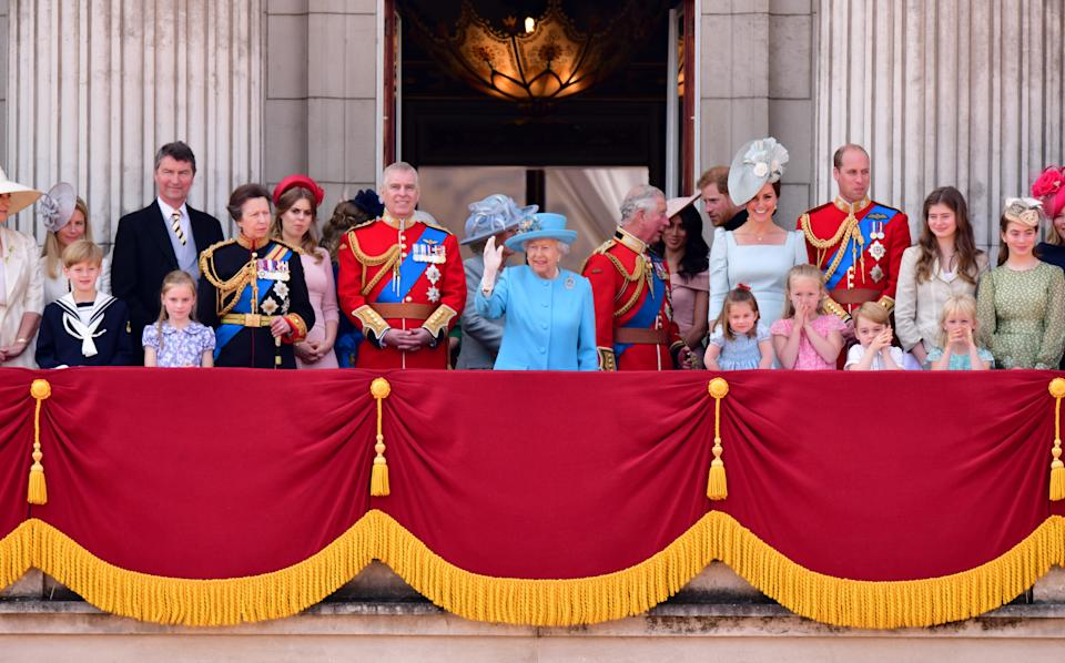 Vice Admiral Sir Tim Laurence, Princess Anne, Princess Royal, Princess Beatrice, Prince Andrew, Duke of York, Camilla, Duchess Of Cornwall, Queen Elizabeth II, Prince Charles, Prince of Wales, Meghan, Duchess of Sussex, Prince Harry, Duke of Sussex, Catherine, Duchess of Cambridge, Prince William, Duke of Cambridge, Princess Charlotte of Cambridge, Savannah Phillips, Prince George of Cambridge and Isla Phillips stand on the balcony of Buckingham Palace during the Trooping the Colour parade on June 9, 2018 in London, England.