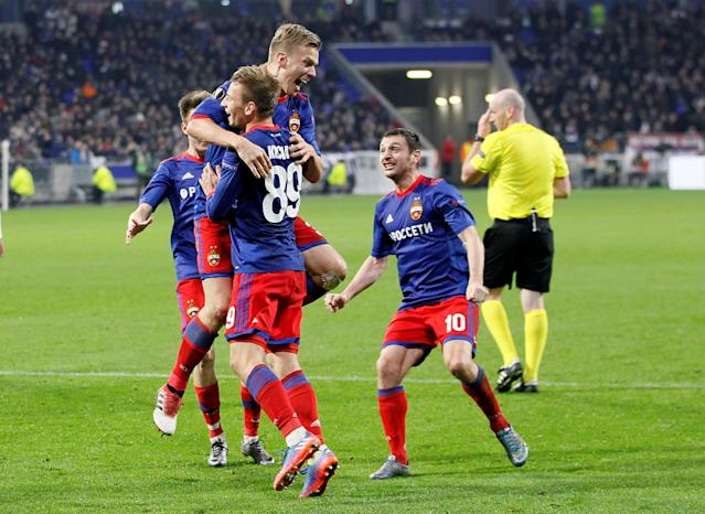 Soccer Football - Europa League Round of 16 Second Leg - Olympique Lyonnais vs CSKA Moscow - Groupama Stadium, Lyon, France - March 15, 2018 CSKA Moscow's Pontus Wernbloom celebrates with Konstantin Kuchaev and Alan Dzagoev after scoring their third goal REUTERS/Emmanuel Foudrot