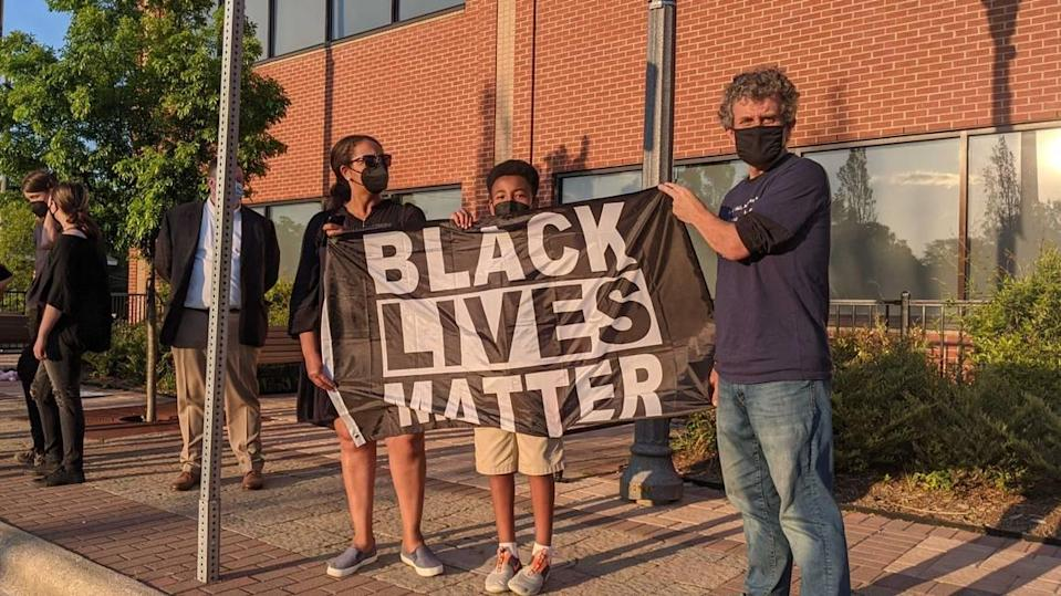 About 25 people gathered outside Fuquay-Varina's Town Hall on April 20, 2021, to protest for Black Lives Matter and to celebrate the guilty verdict in the George Floyd murder trial. The protest was organized by Emancipate NC.