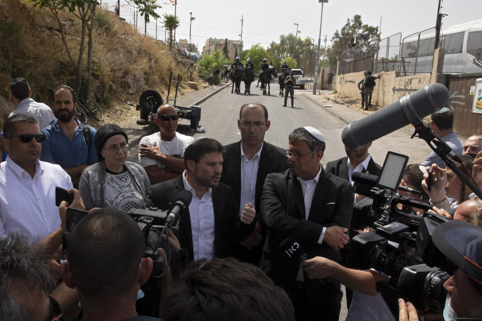 Israeli Knesset members Itamar Ben Gvir, center-right and Bezalel Smotrich, center left, speak to journalists during a visit to the Sheikh Jarrah neighborhood of East Jerusalem, Monday, May 10, 2021. Tensions have been fueled by the planned eviction of dozens of Palestinians from the Sheikh Jarrah neighborhood of east Jerusalem where Israeli settlers have waged a lengthy legal battle to take over properties. (AP Photo/Sebastian Scheiner)