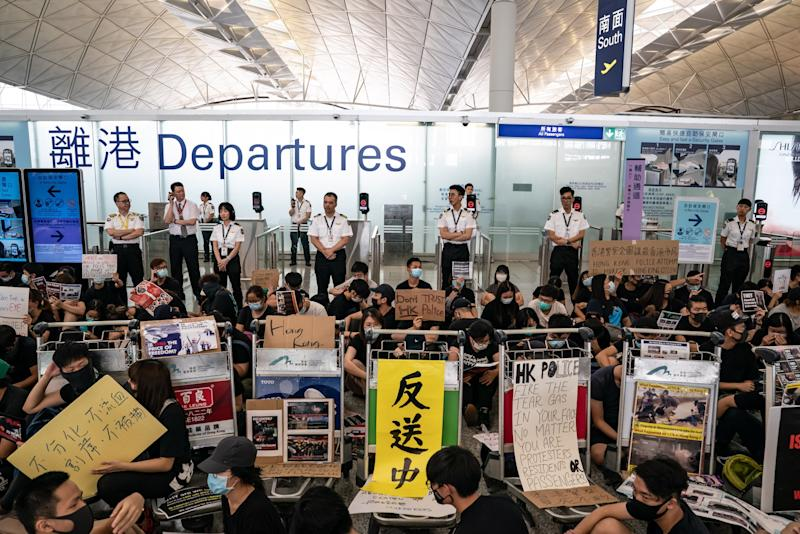 Police Exit Airport as Protesters Dig In: Hong Kong Update
