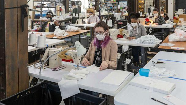 PHOTO: Workers at Detroit Sewn, a contract sewing company, produce medical masks for medical professionals during the coronavirus crisis, April 2, 2020, in Pontiac, Mich. (Jim West/ZUMA Press)