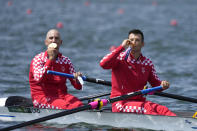 Martin Sinkovic and Valent Sinkovic of Croatia pose with their gold medals after the men's rowing pair final at the 2020 Summer Olympics, Thursday, July 29, 2021, in Tokyo, Japan. (AP Photo/Lee Jin-man)