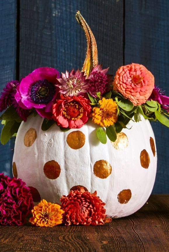 <p>Because pretty pumpkins deserve flower crowns, too. To make, shape floral wire into a wreath. Trim flowers, leaving two to three inches of stem, and attach stems and leaves with additional wire. Crown your painted pumpkin, then leave it out on display all season long. If you go with real flowers, spritz them occasionally to extend their life, but they'll be just as beautiful once they dry out. </p>