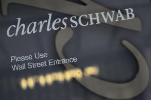 Charles Schwab sign: Credit AP