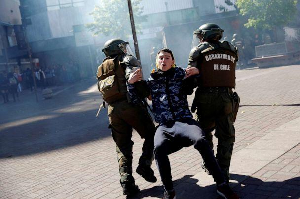 PHOTO: Officers of the Chilean police (Carabineros) detain a demonstrator during protests against Chile's government in Concepcion, Chile, Nov. 4, 2019. (via Reuters)