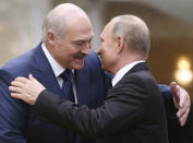 FILE - In this Nov. 30, 2017, file photo, Belarusian President Alexander Lukashenko, left, greets Russian President Vladimir Putin during the Collective Security Council of the Collective Security Treaty Organization (CSTO) summit in Minsk, Belarus. Lukashenko's years of repression and brutality had all but burned his bridges with the West. Faced with massive protests, he had nowhere to turn for help but to Putin, who has said he was prepared to send police to help stabilize the situation if demonstrations turned violent, but he never made the move. (Pool Photo via AP, File)