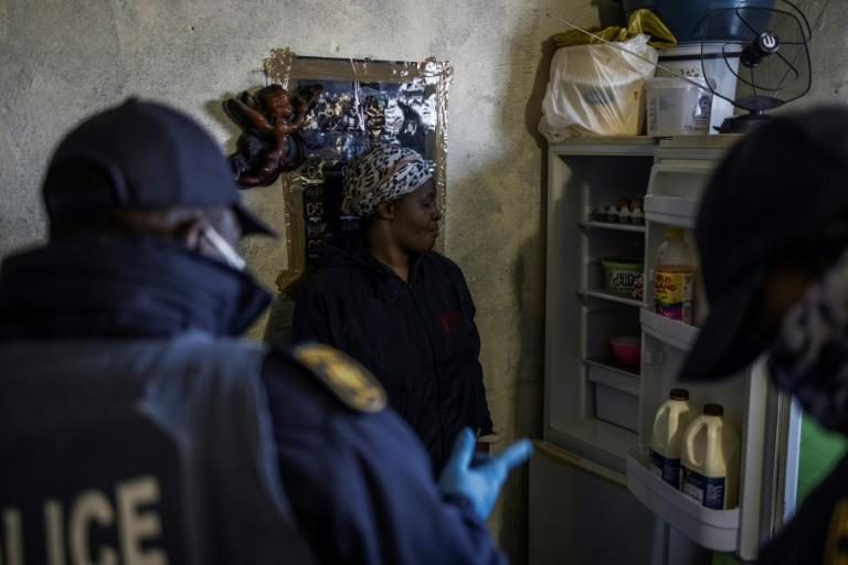 A woman is questioned about the contents of her fridge. Food, more than electronic goods, accounted for most of items that were confiscated on Tuesday