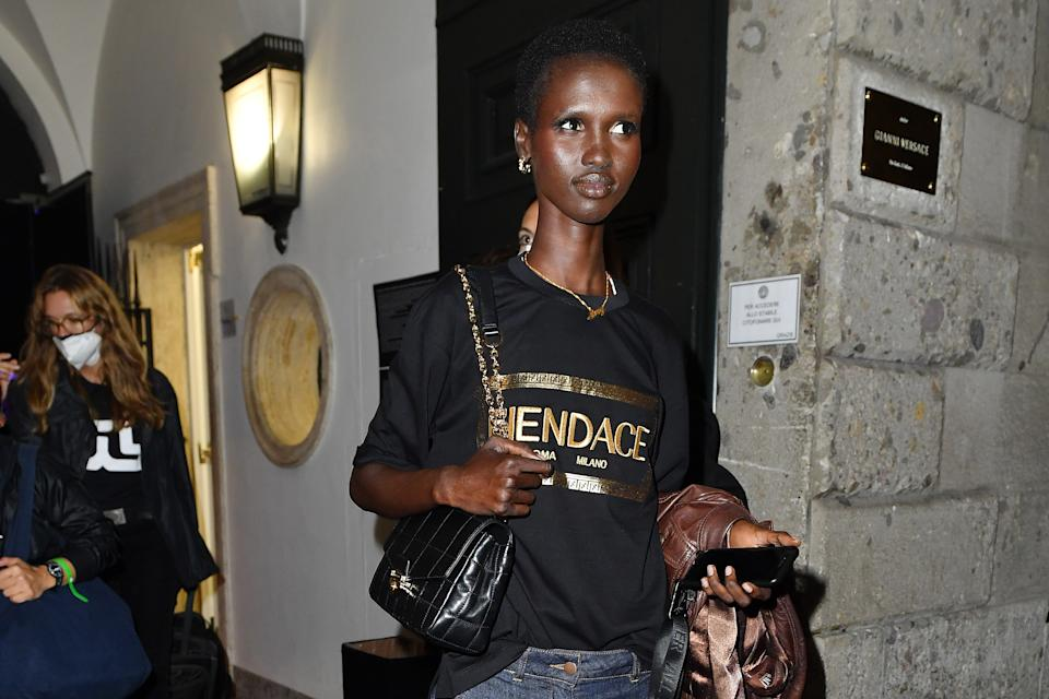 MILAN, ITALY - SEPTEMBER 26: A model wearing a Fendace t-shirt is seen ahead of the Versace special event during the Milan Fashion Week Spring / Summer 2022 on September 26, 2021 in Milan, Italy. (Photo by Jacopo Raule/Getty Images)