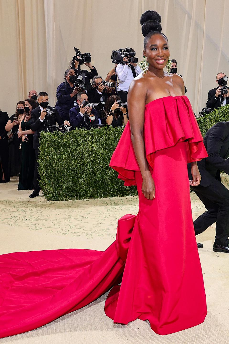 <p>Williams — who told reporters her hair was inspired by African culture — stepped out in a strapless ruby red Prabal Gurung gown.</p>