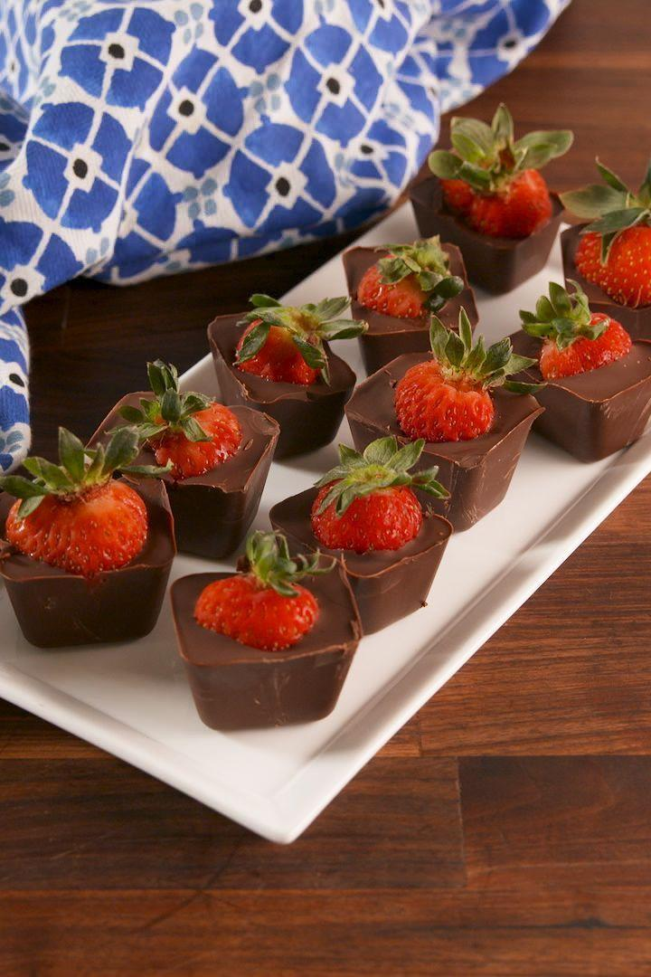 """<p>The perfect chocolate to strawberry ratio. </p><p>Get the <a href=""""https://www.delish.com/uk/cooking/recipes/a33257445/chocolate-covered-strawberry-cubes-recipe/"""" rel=""""nofollow noopener"""" target=""""_blank"""" data-ylk=""""slk:Chocolate Covered Strawberry Cubes"""" class=""""link rapid-noclick-resp"""">Chocolate Covered Strawberry Cubes</a> recipe.</p>"""