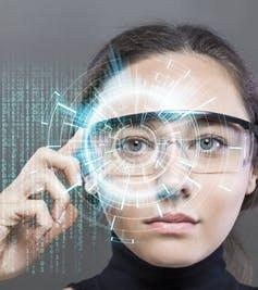 "<span class=""caption"">Wearable tech like smart glasses will be able to get navigation guidance from a local source, making it faster and more reliable.</span> <span class=""attribution""><a class=""link rapid-noclick-resp"" href=""https://www.shutterstock.com/image-photo/young-woman-looking-virtual-graphics-futuristic-669660826"" rel=""nofollow noopener"" target=""_blank"" data-ylk=""slk:Shutterstock"">Shutterstock</a></span>"