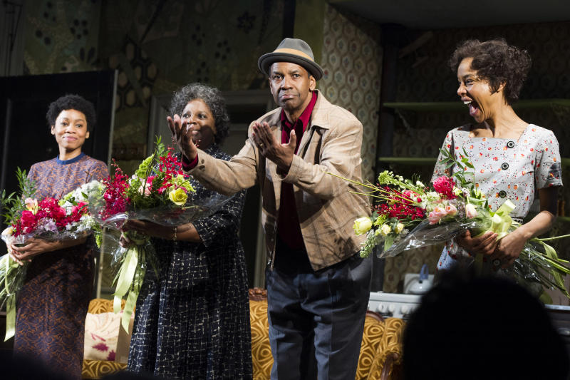"""FILE - In this April 3, 2014 file photo shows Anika Noni Rose, from left, LaTanya Richardson, Denzel Washington and Sophie Okonedo at the curtain call for the opening night of """"A Raisin In The Sun"""" in New York. President Barack Obama and first lady Michelle Obama caught the American masterpiece Friday night, April 11, 2014, at the Ethel Barrymore Theatre, where it first opened more than 50 years ago. They took their seats to huge applause. (Photo by Charles Sykes/Invision/AP, File)"""
