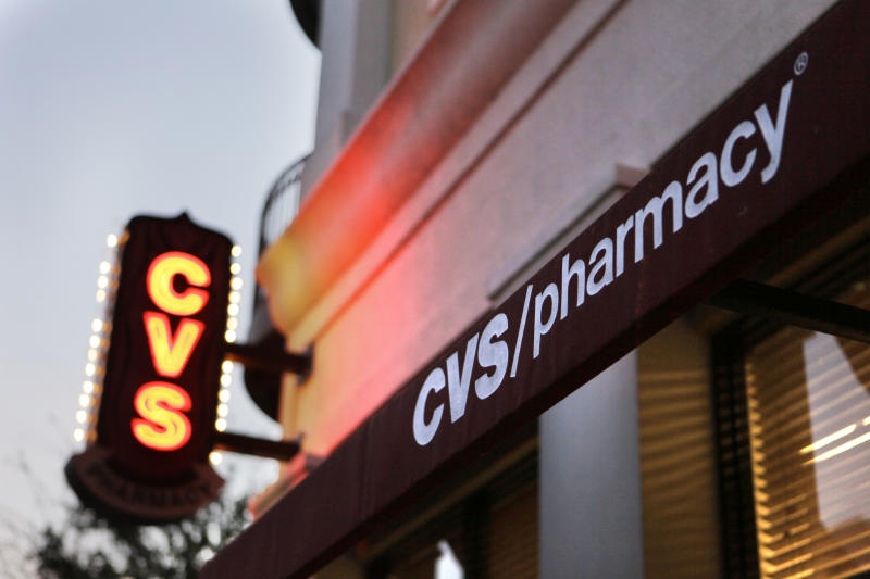 A CVS Pharmacy is seen in Orlando, Fla., Wednesday, Feb. 2, 2011. Drugstore chain and pharmacy benefits manager CVS Caremark Corp. said Thursday, Feb. 3, that its profit fell 2 percent in the fourth quarter on lower revenue because of client losses and fewer Medicare prescription drug program members.(AP Photo/John Raoux)