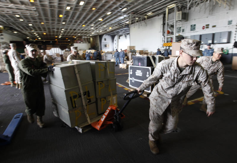 FILE - In this March 8, 2012 file photo, sailors move supplies and equipment as they prepare for the final deployment of the nuclear aircraft carrier USS Enterprise at the Norfolk Naval Station in Norfolk, Va. The U.S. Navy said Monday, April 9, 2012 that it has deployed a second aircraft carrier to the Persian Gulf region amid rising tensions with Iran over its nuclear program. The deployment of the nuclear-powered USS Enterprise along the Abraham Lincoln carrier strike group marks only the fourth time in the past decade that the Navy has had two aircraft carriers operating at the same time in the Persian Gulf and the Arabian Sea, said Cmdr. Amy Derrick-Frost of the Bahrain-based 5th Fleet. (AP Photo/Steve Helber, File)