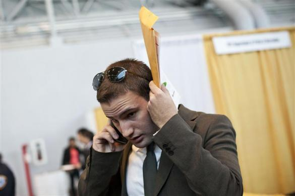 A student speaks on the phone in between meetings with potential employers at the 2012 Big Apple Job and Internship Fair at the Javits Center in New York, April 27, 2012.