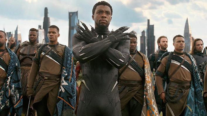Chadwick Boseman wields his claws as Black Panther before an army of Jabari soldiers.