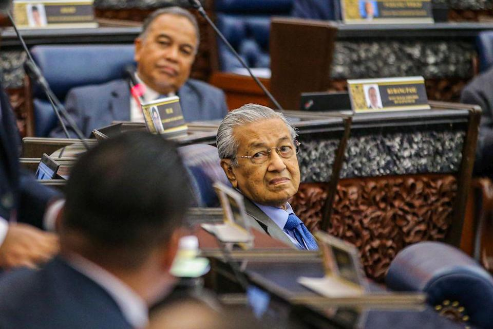 Tun Dr Mahathir Mohamad is pictured during the second meeting of the third session of the 14th Parliament in Kuala Lumpur July 13, 2020. — Picture by Hari Anggara