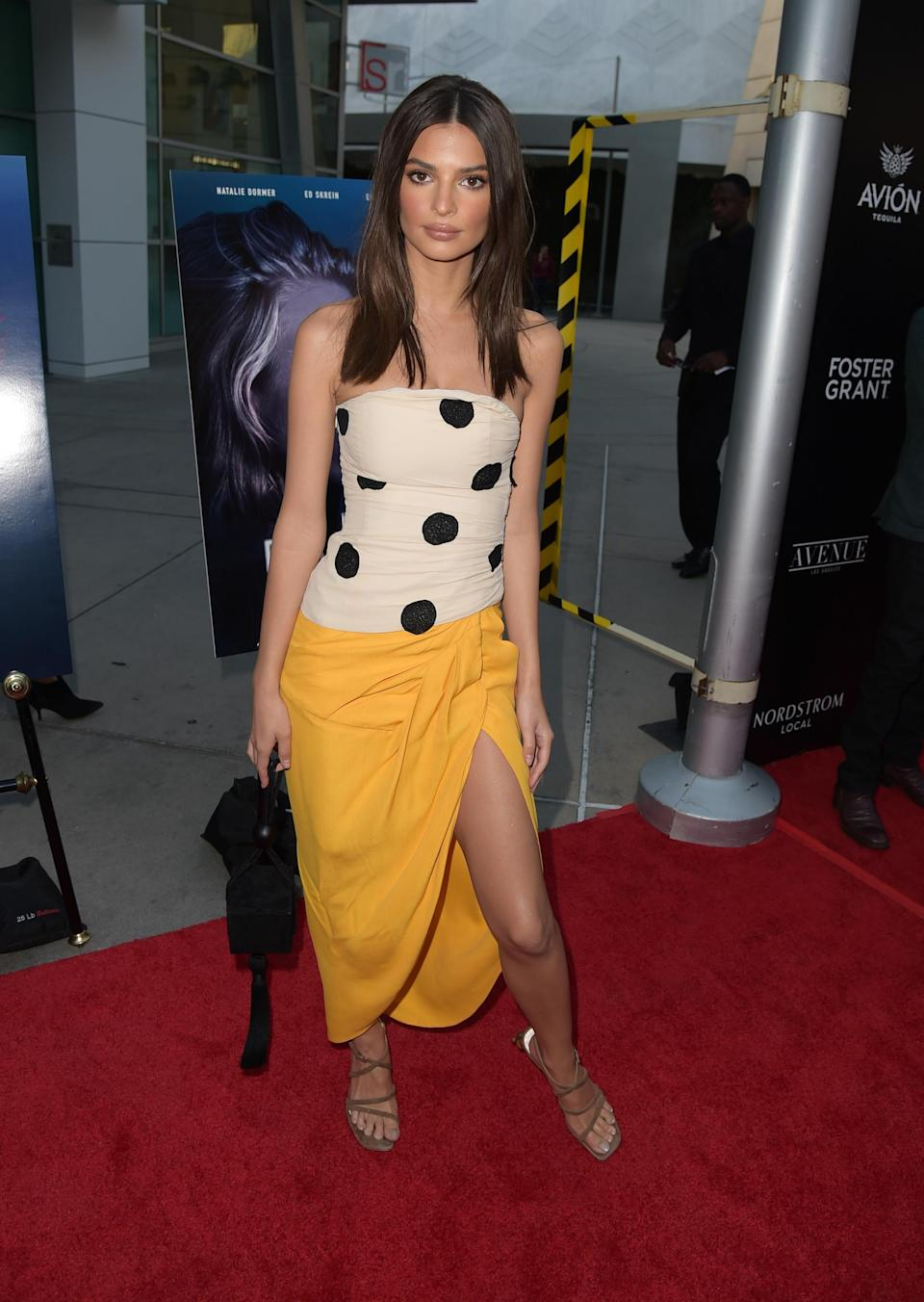 <p>Emily looked summery in a strapless, polk dot Jacquemas top with a mango-coloured skirt. <em>[Photo: Getty]</em> </p>