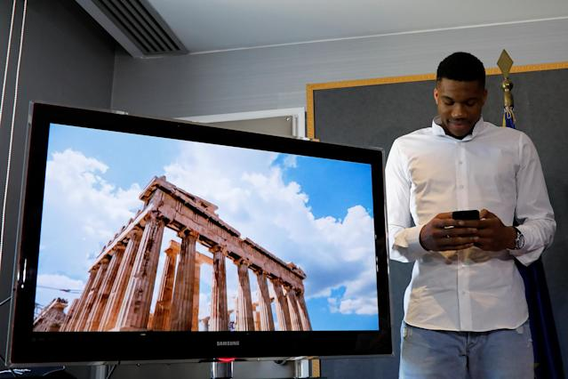 The Parthenon temple is displayed on a screen as NBA All-Star and Milwaukee Bucks forward Giannis Antetokounmpo posts on social media the new Greek Tourism ministry ad campaign in Athens, Greece, June 29, 2018. REUTERS/Alkis Konstantinidis
