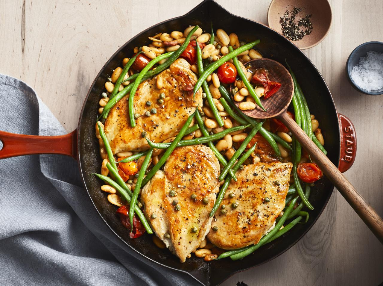 "<p><strong>Try this recipe:</strong> <a href=""https://www.health.com/recipes/lemon-chicken-white-green-beans"">Lemon Chicken With White & Green Beans</a></p> <p>Channel a traditional French dinner with this quick dish by sautéeing chicken, green beans, and white wine dish in a skillet. </p> <p><strong>Ingredients:</strong> chicken breasts, kosher salt, black pepper, olive oil, white wine, chicken broth, cannellini beans, haricots verts, cherry tomatoes, unsalted butter, capers, lemon juice</p> <p><strong>Calories:</strong> 378</p>"
