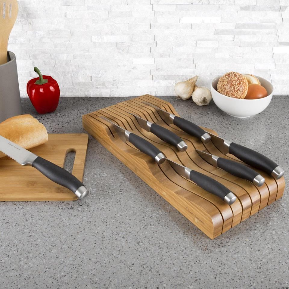 <p>Keep your knives in good condition with this <span>In Drawer Bamboo Knife Block and Cutlery Storage Organizer</span> ($19). It holds up to 15 knives.</p>