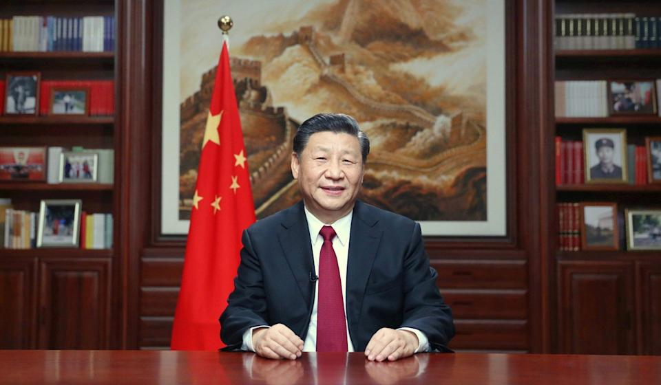 Chinese President Xi Jinping delivers his New Year's Eve message on state television. Photo: Xinhua