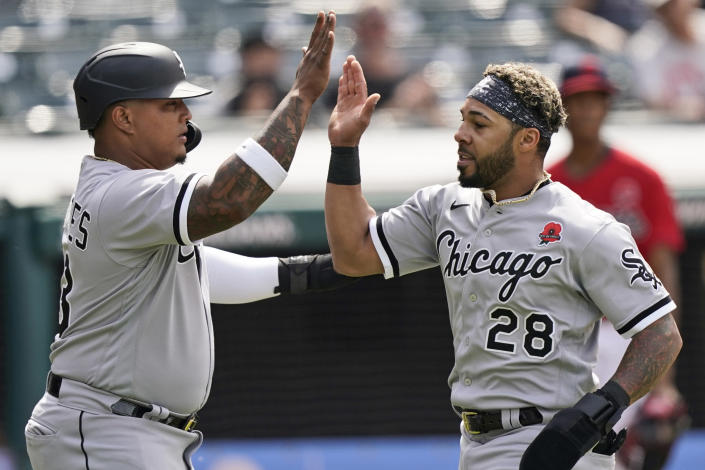 Chicago White Sox's Leury Garcia, right, and Yermin Mercedes celebrate after both score in the second inning of the first baseball game of a doubleheader against the Cleveland Indians, Monday, May 31, 2021, in Cleveland. (AP Photo/Tony Dejak)