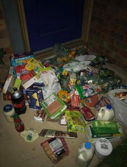 A customer was shocked to find his Woolworths delivery scattered at his front door. Source: Facebook