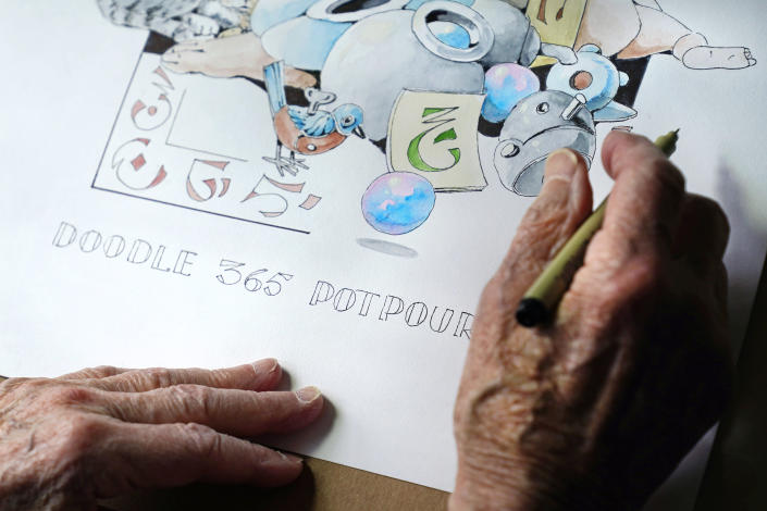 """Artist Robert Seaman works on his 365th daily doodle in his room at an assisted living facility Monday, May 10, 2021, in Westmoreland, N.H. Seaman, who moved into the facility weeks before the COVID-19 pandemic shutdown his outside world in 2020, recently completed his 365th daily sketch, or what he calls his """"Covid Doodles"""", since being isolated due to the virus outbreak. (AP Photo/Charles Krupa)"""