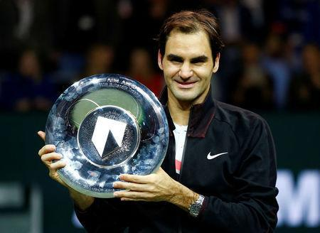 Tennis - ATP 500 - Rotterdam Open - Final - Ahoy, Rotterdam, Netherlands - February 18, 2018 - Roger Federer of Switzerland holds the trophy after winning against Grigor Dimitrov of Bulgaria. REUTERS/Michael Kooren