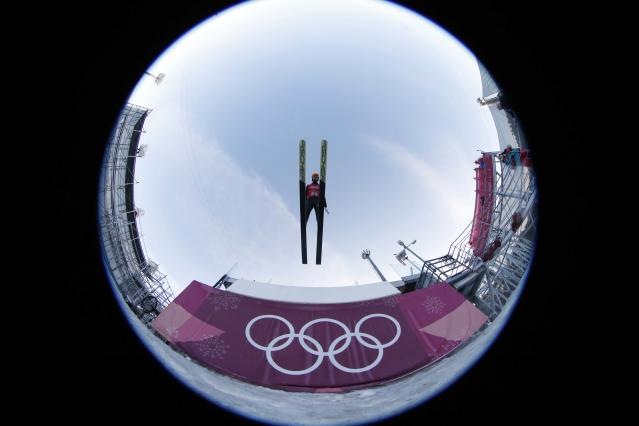 Nordic Combined Events - Pyeongchang 2018 Winter Olympics - Team LH Training - Alpensia Ski Jumping Centre - Pyeongchang, South Korea - February 21, 2018 - Takehiro Watanabe of Japan trains. Picture taken with a fisheye lens. REUTERS/Jorge Silva